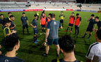 Ralph Hasenhuttl speaks to young local players during a Southampton FC training session while on their Pre Season trip to Macau, China, 22nd July 2019
