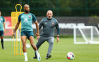 SOUTHAMPTON, ENGLAND - AUGUST 08: LtoR Nathan Redmond Craig Fleming during a first team training session pictured at Staplewood Training Ground on August 06, 2019 in Southampton, England. (Photo by James Bridle - Southampton FC/Southampton FC via Getty Images)