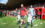 SOUTHAMPTON, ENGLAND - AUGUST 17: Pierre-Emile Hojbjerg of Southampton leads the teams out with the match day mascot during the Premier League match between Southampton FC and Liverpool FC at St Mary's Stadium on August 17, 2019 in Southampton, United Kingdom. (Photo by Matt Watson/Southampton FC via Getty Images)