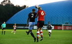 SOUTHAMPTON, ENGLAND - AUGUST 19: Christoph Klarer heads the ball (right) during the match between Southampton FC and Derby County FC pictured at Staplewood Training Ground on August 19, 2019 in Southampton, England. (Photo by James Bridle - Southampton FC/Southampton FC via Getty Images)