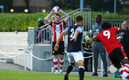 SOUTHAMPTON, ENGLAND - AUGUST 19: Kameron Ledwidge makes a throw in during the match between Southampton FC and Derby County FC pictured at Staplewood Training Ground on August 19, 2019 in Southampton, England. (Photo by James Bridle - Southampton FC/Southampton FC via Getty Images)