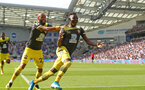 BRIGHTON, ENGLAND - AUGUST 24: Moussa Djenepo(R) of Southampton celebrates with Nathan Redmond(L) after opening the scoring during the Premier League match between Brighton & Hove Albion and Southampton FC at American Express Community Stadium on August 24, 2019 in Brighton, United Kingdom. (Photo by Matt Watson/Southampton FC via Getty Images)