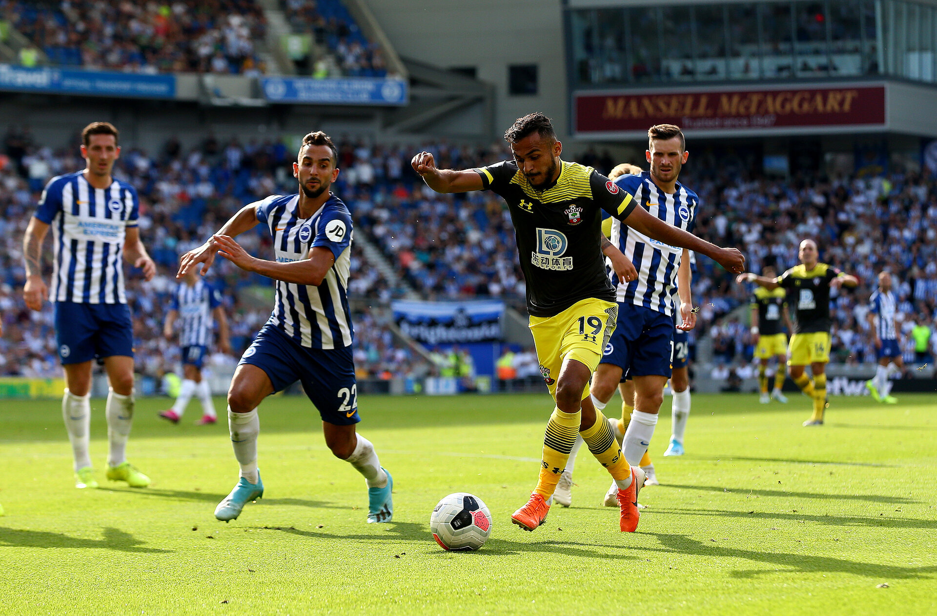 BRIGHTON, ENGLAND - AUGUST 24: Sofiane Boufal(R) of Southampton shoots across goal for Nathan Redmond(out of shot) to score during the Premier League match between Brighton & Hove Albion and Southampton FC at American Express Community Stadium on August 24, 2019 in Brighton, United Kingdom. (Photo by Matt Watson/Southampton FC via Getty Images)