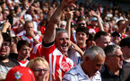 BRIGHTON, ENGLAND - AUGUST 24: Fans of Southampton during the Premier League match between Brighton & Hove Albion and Southampton FC at American Express Community Stadium on August 24, 2019 in Brighton, United Kingdom. (Photo by Matt Watson/Southampton FC via Getty Images)