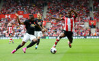 SOUTHAMPTON, ENGLAND - AUGUST 31: Aaron Wan-Bissaka(L) of Manchester United and Kevin Danso(R) of Southampton during the Premier League match between Southampton FC and Manchester United at St Mary's Stadium on August 31, 2019 in Southampton, United Kingdom. (Photo by Matt Watson/Southampton FC via Getty Images)