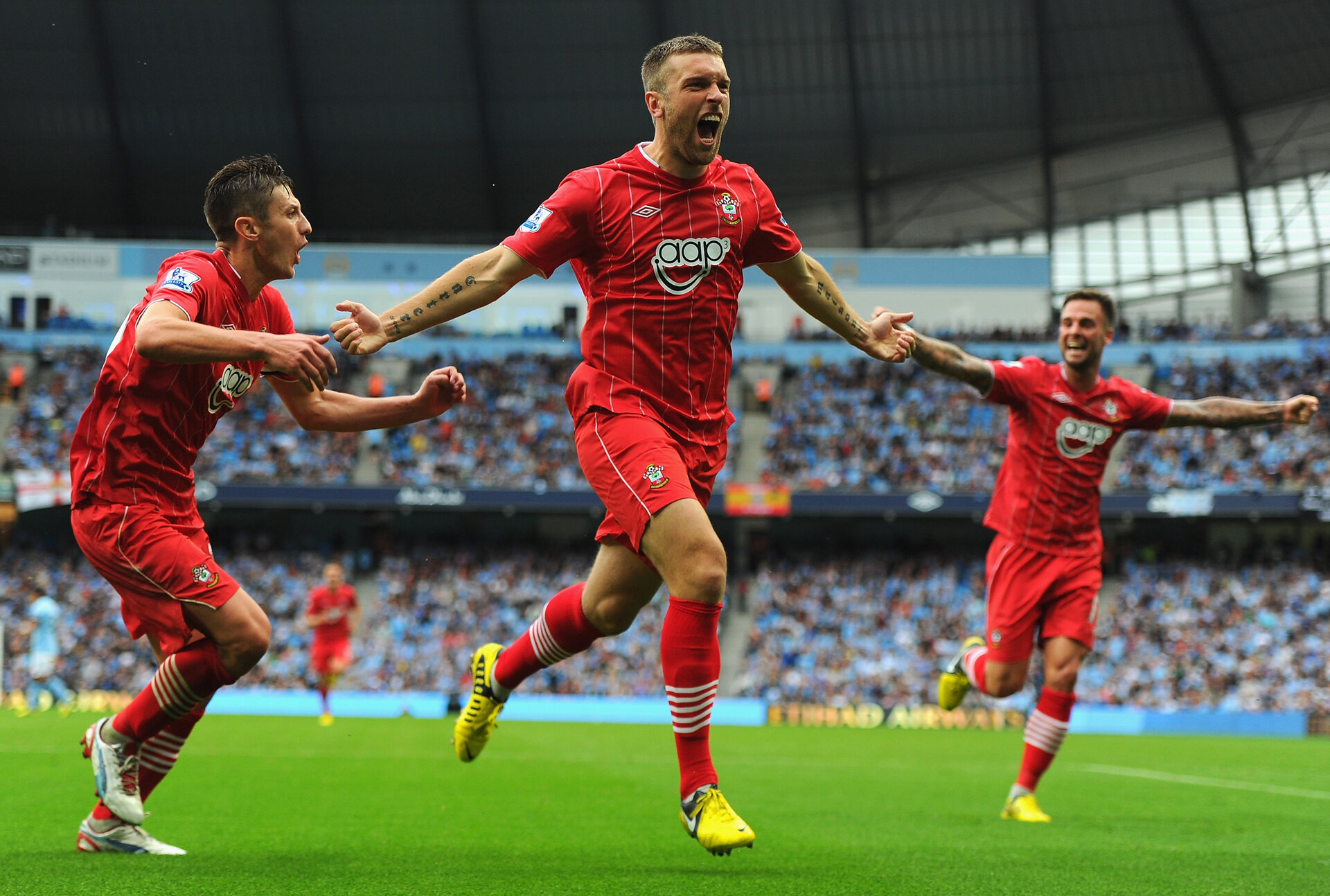 MANCHESTER, ENGLAND - AUGUST 19:  Rickie Lambert of Southampton celebrates scoring his team's first goal during the Barclays Premier League match between Manchester City and Southampton at Etihad Stadium on August 19, 2012 in Manchester, England.  (Photo by Michael Regan/Getty Images)