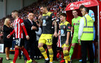 SHEFFIELD, ENGLAND - SEPTEMBER 14: Pierre-Emile Hojbjerg of Southampton leads the teams out with the match day mascot during the Premier League match between Sheffield United and Southampton FC at Bramall Lane on September 14, 2019 in Sheffield, United Kingdom. (Photo by Matt Watson/Southampton FC via Getty Images)