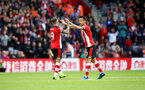 SOUTHAMPTON, ENGLAND - OCTOBER 06: Danny Ings(L) and Maya Yoshida of Southampton during the Premier League match between Southampton FC and Chelsea FC at St Mary's Stadium on October 06, 2019 in Southampton, United Kingdom. (Photo by Matt Watson/Southampton FC via Getty Images)