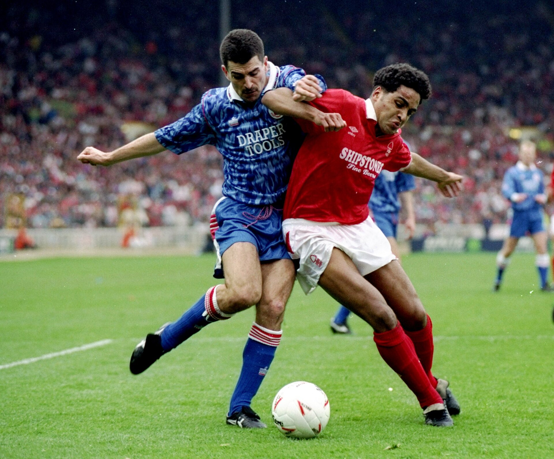 29 Mar 1992:  Gary Charles of Nottingham Forest fends off Francis Benali of Southampton during the Zenith Data Cup final at Wembley Stadium in London. Nottingham Forest won the match 3-2. \ Mandatory Credit: Shaun  Botterill/Allsport