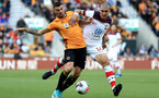 WOLVERHAMPTON, ENGLAND - OCTOBER 19: Patrick Cutrone of Wolverhampton Wanderers battles for possession with Oriol Romeu of Southampton during the Premier League match between Wolverhampton Wanderers and Southampton FC at Molineux on October 19, 2019 in Wolverhampton, United Kingdom. (Photo by Matthew Lewis/Getty Images)