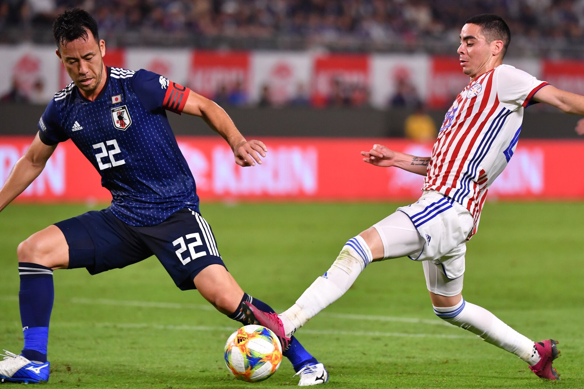 Paraguay's forward Miguel Almiron (R) fights for the ball with Japan's defender Maya Yoshida during the international friendly football match between Japan and Paraguay at the Kashima Soccer stadium in Kashima, Ibaraki prefecture on September 5, 2019. (Photo by Toshifumi KITAMURA / AFP)        (Photo credit should read TOSHIFUMI KITAMURA/AFP via Getty Images)