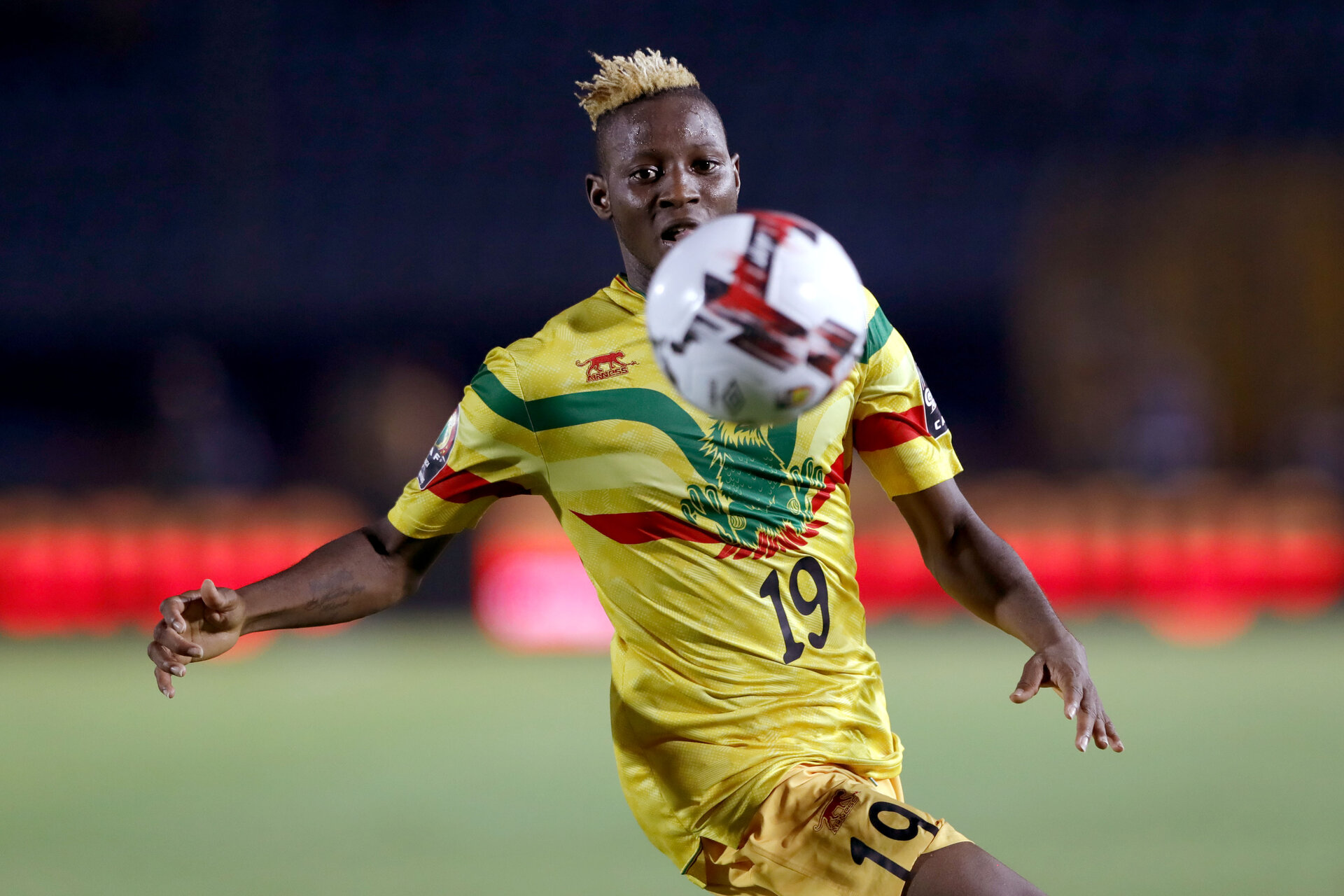 Mali's forward Moussa Djenepo eyes the ball during the 2019 Africa Cup of Nations (CAN) Round of 16 football match between Ivory Coast and Mali at the Suez Stadium in the north-eastern Egyptian city on July 8, 2019. (Photo by FADEL SENNA / AFP)        (Photo credit should read FADEL SENNA/AFP via Getty Images)