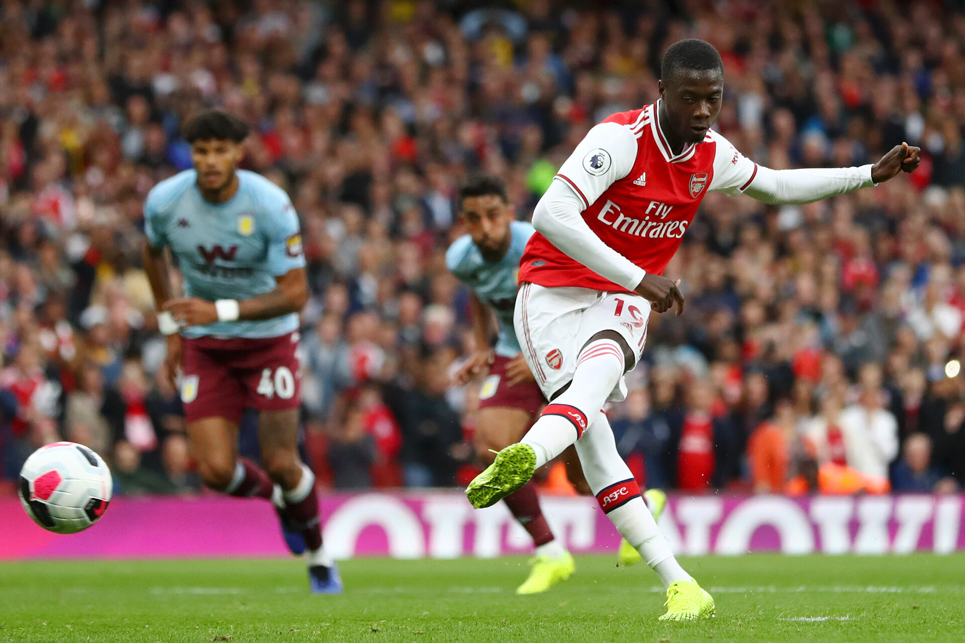 LONDON, ENGLAND - SEPTEMBER 22: Nicolas Pepe of Arsenal converts his sides penalty and scores their first goal of the game during the Premier League match between Arsenal FC and Aston Villa at Emirates Stadium on September 22, 2019 in London, United Kingdom. (Photo by Michael Steele/Getty Images)