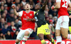 LONDON, ENGLAND - NOVEMBER 23: Sokratis Papastathopoulos(L) of Arsenal and Michael Obafemi(R) of Southampton during the Premier League match between Arsenal FC and Southampton FC at Emirates Stadium on November 23, 2019 in London, United Kingdom. (Photo by Matt Watson/Southampton FC via Getty Images)