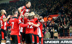 SOUTHAMPTON, ENGLAND - DECEMBER 04: Cedric Soares jumps on his team mates after Danny Ings scores during the Premier League match between Southampton FC and Norwich City at St Mary's Stadium on December 04, 2019 in Southampton, United Kingdom. (Photo by Matt Watson/Southampton FC via Getty Images)
