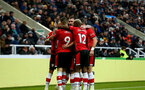 NEWCASTLE UPON TYNE, ENGLAND - DECEMBER 08: Southampton players celebrate during the Premier League match between Newcastle United and Southampton FC at St. James Park on December 08, 2019 in Newcastle upon Tyne, United Kingdom. (Photo by Matt Watson/Southampton FC via Getty Images)