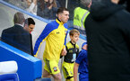 LONDON, ENGLAND - DECEMBER 26: Pierre-Emile Hojbjerg of Southampton leads his team out with the match day mascot during the Premier League match between Chelsea FC and Southampton FC at Stamford Bridge on December 26, 2019 in London, United Kingdom. (Photo by Matt Watson/Getty Images)