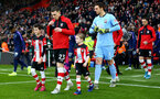 SOUTHAMPTON, ENGLAND - JANUARY 01: Pierre-Emile Hojbjerg of Southampton leads the teams out with the match day mascot during the Premier League match between Southampton FC and Tottenham Hotspur at St Mary's Stadium on January 01, 2020 in Southampton, United Kingdom. (Photo by Matt Watson/Southampton FC via Getty Images)