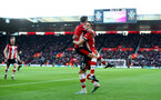 SOUTHAMPTON, ENGLAND - JANUARY 18: Jack Stephens(L) and Jan Bednarek of Southampton celebrate together after Jan Bednarek scores during the Premier League match between Southampton FC and Wolverhampton Wanderers at St Mary's Stadium on January 18, 2020 in Southampton, United Kingdom. (Photo by Matt Watson/Southampton FC via Getty Images)