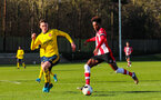 SOUTHAMPTON, ENGLAND - JANUARY 18: Ramello Mitchell of Southampton FC shoots during the Barclays Under 18 Premier League match between Southampton FC and Arsenal FC at the Staplewood Campus on January 18, 2020 in Southampton, England
