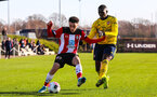 SOUTHAMPTON, ENGLAND - JANUARY 18: Jayden Smith of Southampton FC battles for possession during the Barclays Under 18 Premier League match between Southampton FC and Arsenal FC at the Staplewood Campus on January 18, 2020 in Southampton, England