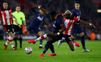 SOUTHAMPTON, ENGLAND - JANUARY 25: Moussa Djenepo(R) of Southampton and Serge Aurier(L) of Tottenham Hotspur during the FA Cup Fourth Round match between Southampton FC and Tottenham Hotspur at St. Mary's Stadium on January 25, 2020 in Southampton, England. (Photo by Matt Watson/Southampton FC via Getty Images)