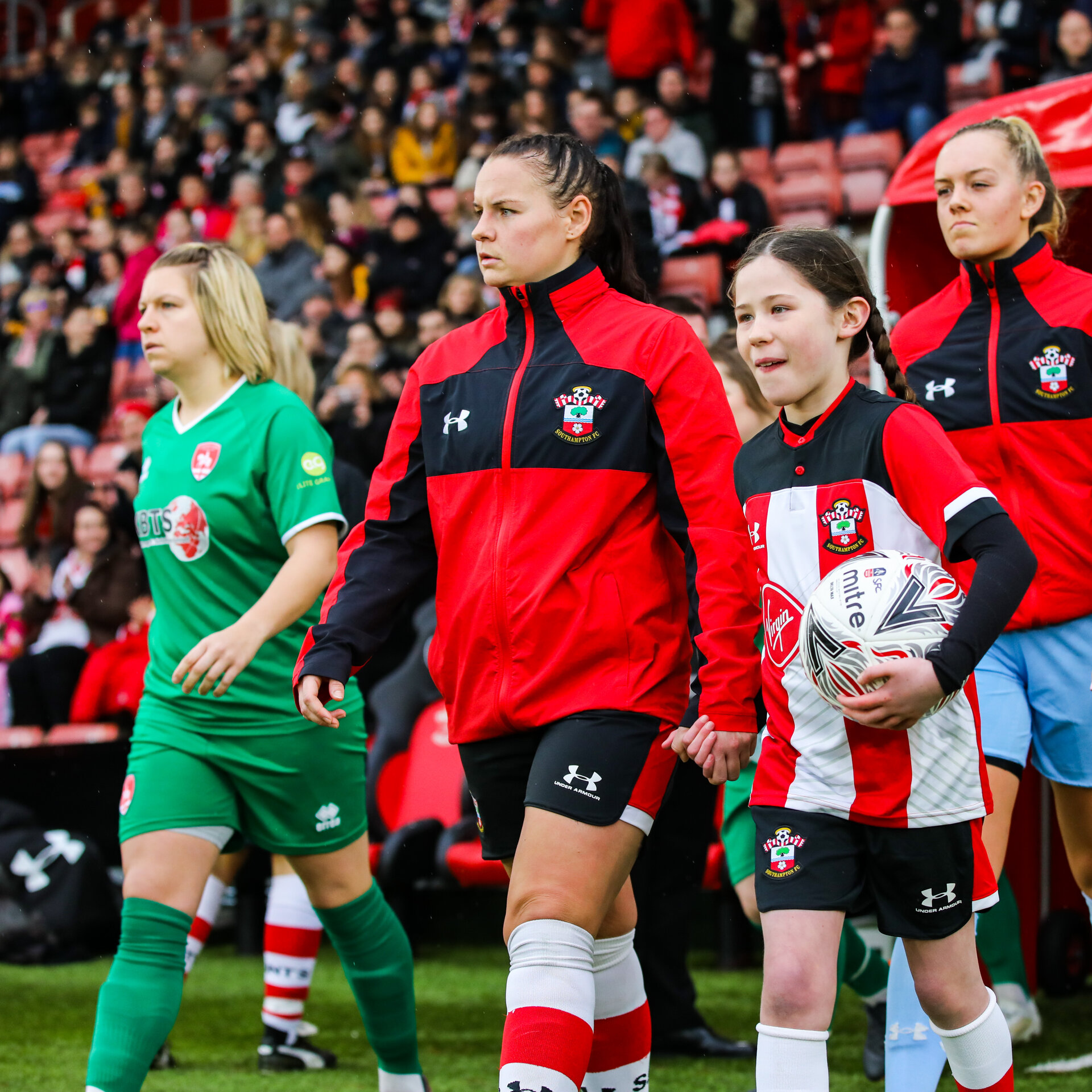 SOUTHAMPTON, ENGLAND - JANUARY 26: Shannon Sievwright of Southampton Womens FC walks out with a mascot during the Women's FA Cup Fourth Round match between Southampton Womens FC and Coventry United Ladies at St Mary's Stadium on January 26, 2020 in Southampton, England