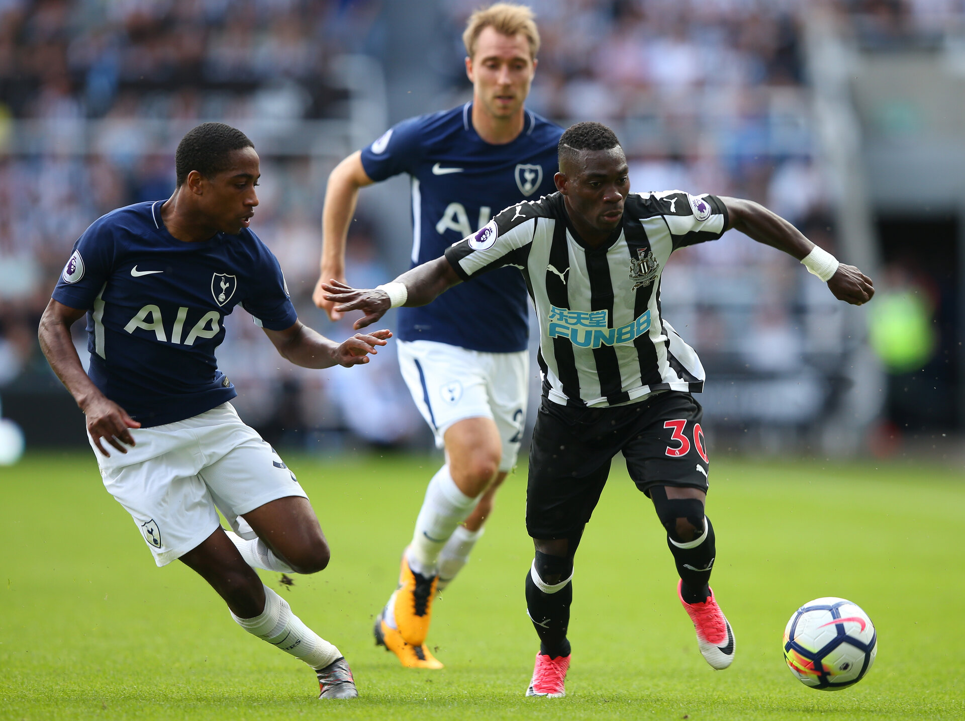 NEWCASTLE UPON TYNE, ENGLAND - AUGUST 13:  Christian Atsu of Newcastle United and Kyle Walker-Peters of Tottenham Hotspur battle for possession during the Premier League match between Newcastle United and Tottenham Hotspur at St. James Park on August 13, 2017 in Newcastle upon Tyne, England.  (Photo by Alex Livesey/Getty Images)