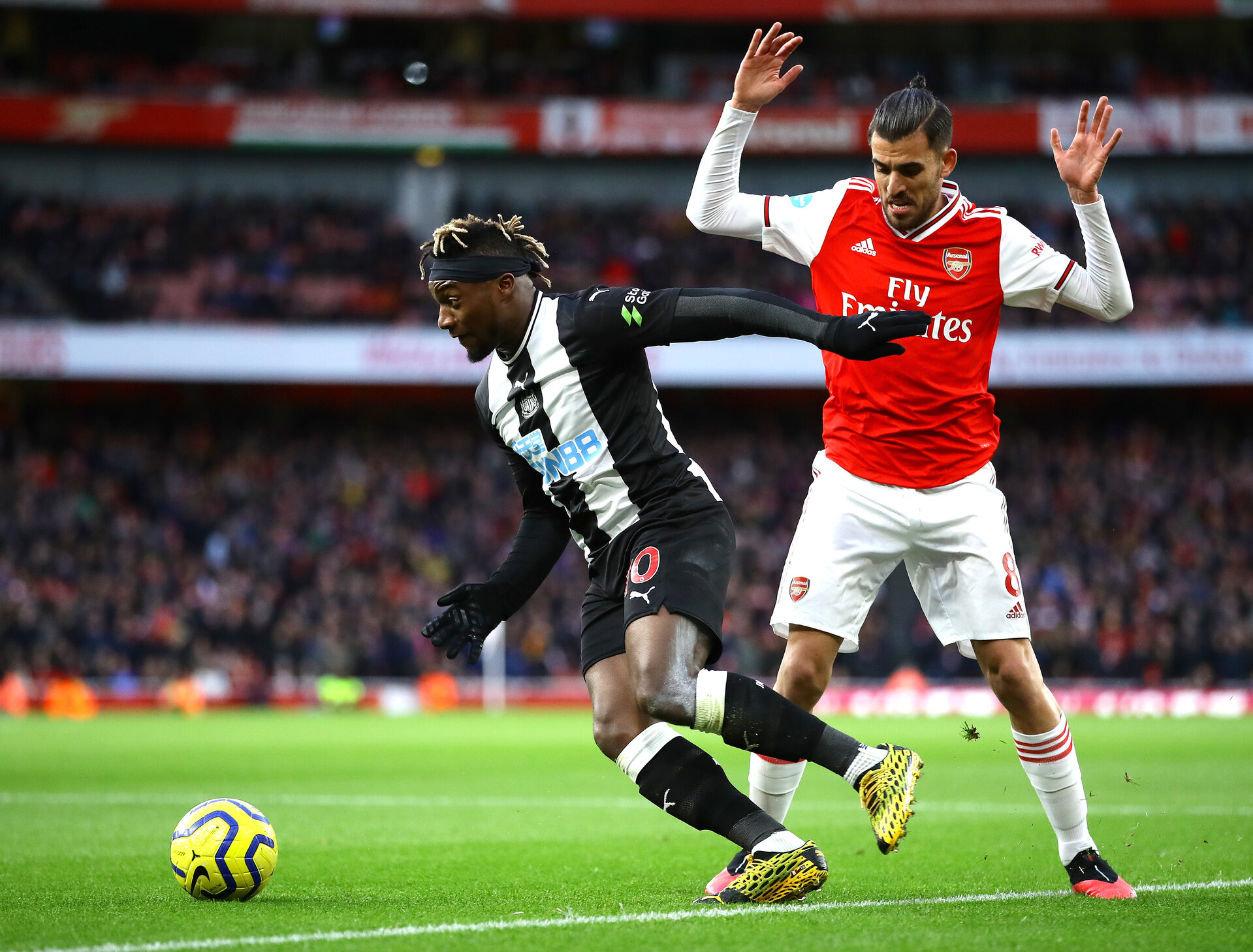 LONDON, ENGLAND - FEBRUARY 16: Allan Saint-Maximin of Newcastle United goes past Dani Ceballos of Arsenal during the Premier League match between Arsenal FC and Newcastle United at Emirates Stadium on February 16, 2020 in London, United Kingdom. (Photo by Richard Heathcote/Getty Images)