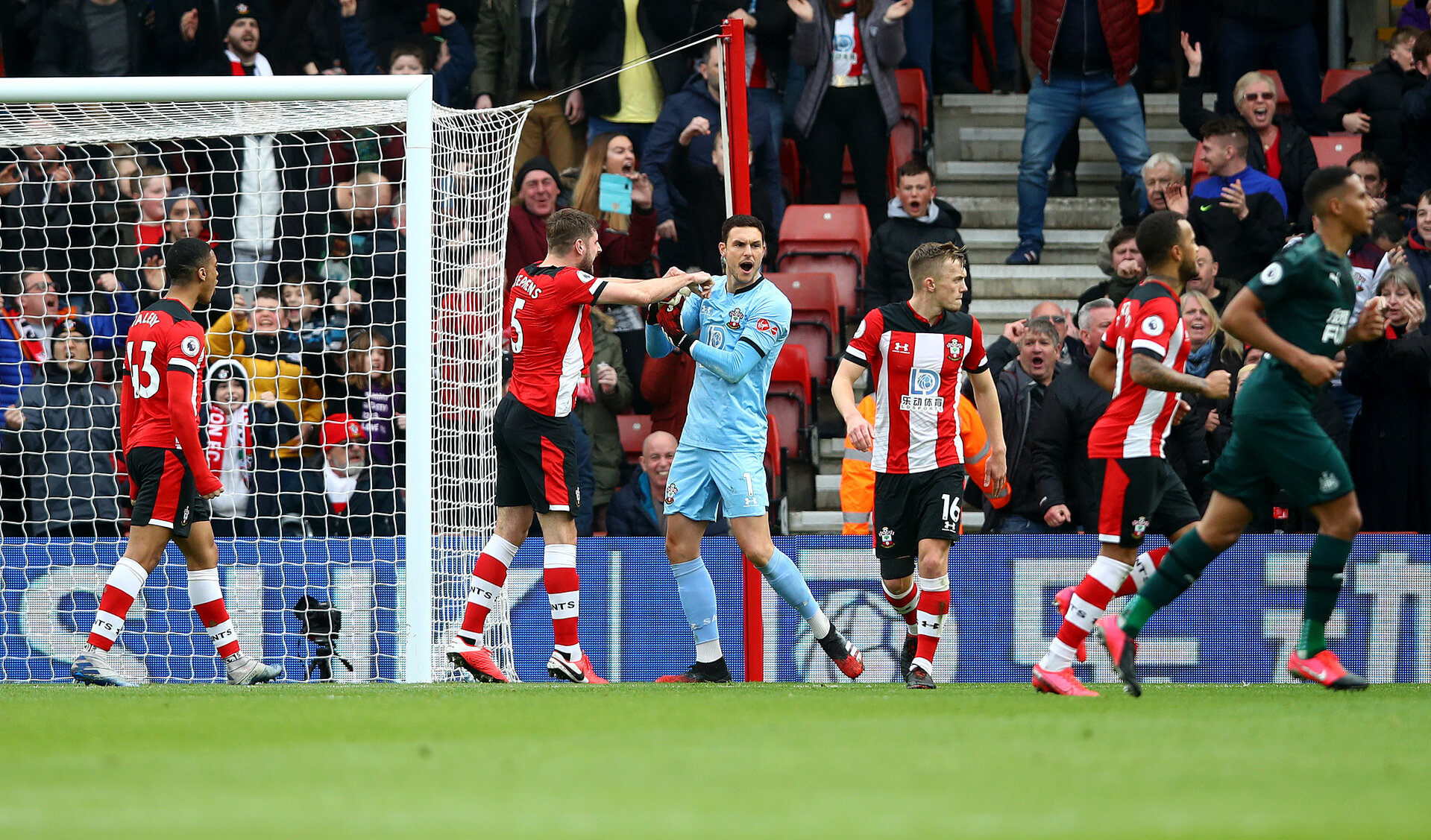 SOUTHAMPTON, ENGLAND - MARCH 07: Alex McCarthy of Southampton celebrates after saving a penalty during the Premier League match between Southampton FC and Newcastle United at St Mary's Stadium on March 07, 2020 in Southampton, United Kingdom. (Photo by Matt Watson/Southampton FC via Getty Images)