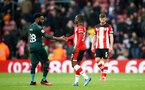 SOUTHAMPTON, ENGLAND - MARCH 07: Danny Rose(L) of Newcastle United and Michael Obafemi of Southampton shake hands during the Premier League match between Southampton FC and Newcastle United at St Mary's Stadium on March 07, 2020 in Southampton, United Kingdom. (Photo by Matt Watson/Southampton FC via Getty Images)