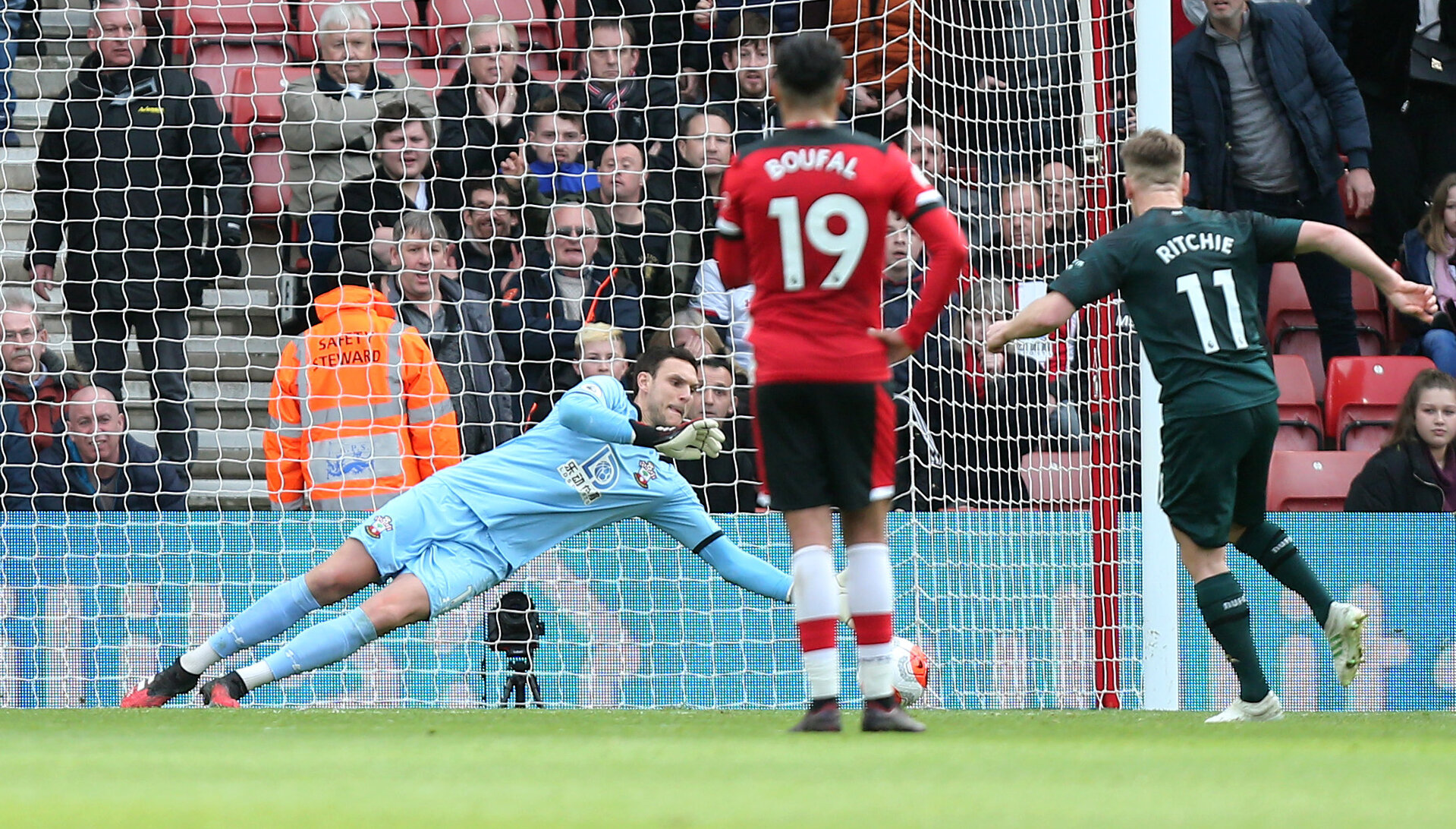 SOUTHAMPTON, ENGLAND - MARCH 07: Alex McCarthy saves a penalty during the Premier League match between Southampton FC and Newcastle United at St Mary's Stadium on March 7, 2020 in Southampton, United Kingdom. (Photo by Chris Moorhouse/Southampton FC via Getty Images)