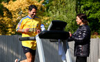SOUTHAMPTON, ENGLAND - APRIL 26: Former Southampton FC player and current club ambassador Francis Benali, runs the distance of a marathon on a treadmill in his garden at his home, as part of the 2.6 challenge and to raise money for Saints Foundation and NHS Charities Trust, his wife Karen cheers him on, on April 26, 2020 in Southampton, England. (Photo by Matt Watson/Southampton FC via Getty Images)
