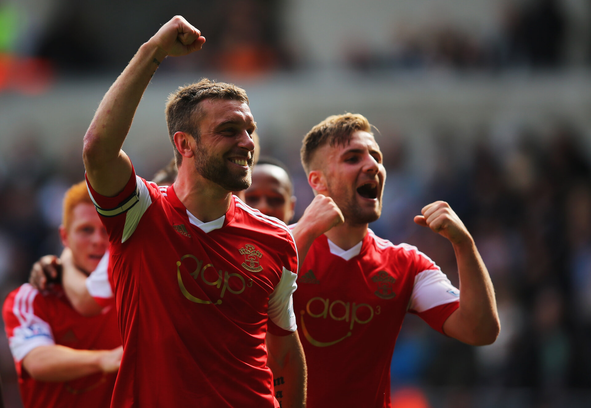 SWANSEA, WALES - MAY 03:  Rickie Lambert of Southampton celebrates with Luke Shaw (R) as he scores their first goal during the Barclays Premier League match between Swansea City and Southampton at Liberty Stadium on May 3, 2014 in Swansea, Wales.  (Photo by Clive Rose/Getty Images)
