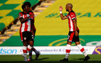 NORWICH, ENGLAND - JUNE 19: (L) Michael Obafemi and Nathan Redmond (R) goal celebration during the Premier League match between Norwich City and Southampton FC at Carrow Road on June 19, 2020 in Norwich, United Kingdom. (Photo by Matt Watson/Southampton FC via Getty Images)