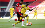 SOUTHAMPTON, ENGLAND - JUNE 25: (L) Kyle Walker-Peters and (R) Bukayo Saka during the Premier League match between Southampton FC and Arsenal FC at St Mary's Stadium on March 21, 2020 in Southampton, United Kingdom. (Photo by Chris Moorhouse/Southampton FC via Getty Images)