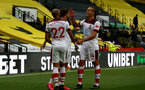 WATFORD, ENGLAND - JUNE 28: (L) Nathan Redmond, Danny Ings and (R) Oriol Romeu during the Premier League match between Watford FC and Southampton FC at Vicarage Road on April 4, 2020 in Watford, United Kingdom. (Photo by Matt Watson/Southampton FC via Getty Images)