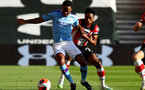 SOUTHAMPTON, ENGLAND - JULY 05: Raheem Sterling (L) and Kyle Walker-Peters (R) during the Premier League match between Southampton FC and Manchester City at St Mary's Stadium on July 5, 2020 in Southampton, United Kingdom. Football Stadiums around Europe remain empty due to the Coronavirus Pandemic as Government social distancing laws prohibit fans inside venues resulting in games being played behind closed doors. (Photo by Matt Watson/Southampton FC via Getty Images)