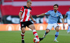 SOUTHAMPTON, ENGLAND - JULY 05: Oriol Romeu (L) and Bernardo Silva (R)  during the Premier League match between Southampton FC and Manchester City at St Mary's Stadium on July 5, 2020 in Southampton, United Kingdom. Football Stadiums around Europe remain empty due to the Coronavirus Pandemic as Government social distancing laws prohibit fans inside venues resulting in games being played behind closed doors. (Photo by Matt Watson/Southampton FC via Getty Images)