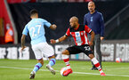 SOUTHAMPTON, ENGLAND - JULY 05: Joao Cancelo (L) and Nathan Redmond (R)  during the Premier League match between Southampton FC and Manchester City at St Mary's Stadium on July 5, 2020 in Southampton, United Kingdom. Football Stadiums around Europe remain empty due to the Coronavirus Pandemic as Government social distancing laws prohibit fans inside venues resulting in games being played behind closed doors. (Photo by Matt Watson/Southampton FC via Getty Images)