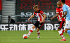 SOUTHAMPTON, ENGLAND - JULY 05: Stuart Armstrong during the Premier League match between Southampton FC and Manchester City at St Mary's Stadium on July 5, 2020 in Southampton, United Kingdom. Football Stadiums around Europe remain empty due to the Coronavirus Pandemic as Government social distancing laws prohibit fans inside venues resulting in games being played behind closed doors. (Photo by Matt Watson/Southampton FC via Getty Images)
