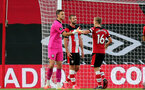 SOUTHAMPTON, ENGLAND - JULY 05: Alex McCarthy (L) Jack Stephens and James Ward-Prowse (R) during the Premier League match between Southampton FC and Manchester City at St Mary's Stadium on July 5, 2020 in Southampton, United Kingdom. Football Stadiums around Europe remain empty due to the Coronavirus Pandemic as Government social distancing laws prohibit fans inside venues resulting in games being played behind closed doors. (Photo by Chris Moorhouse/Southampton FC via Getty Images)