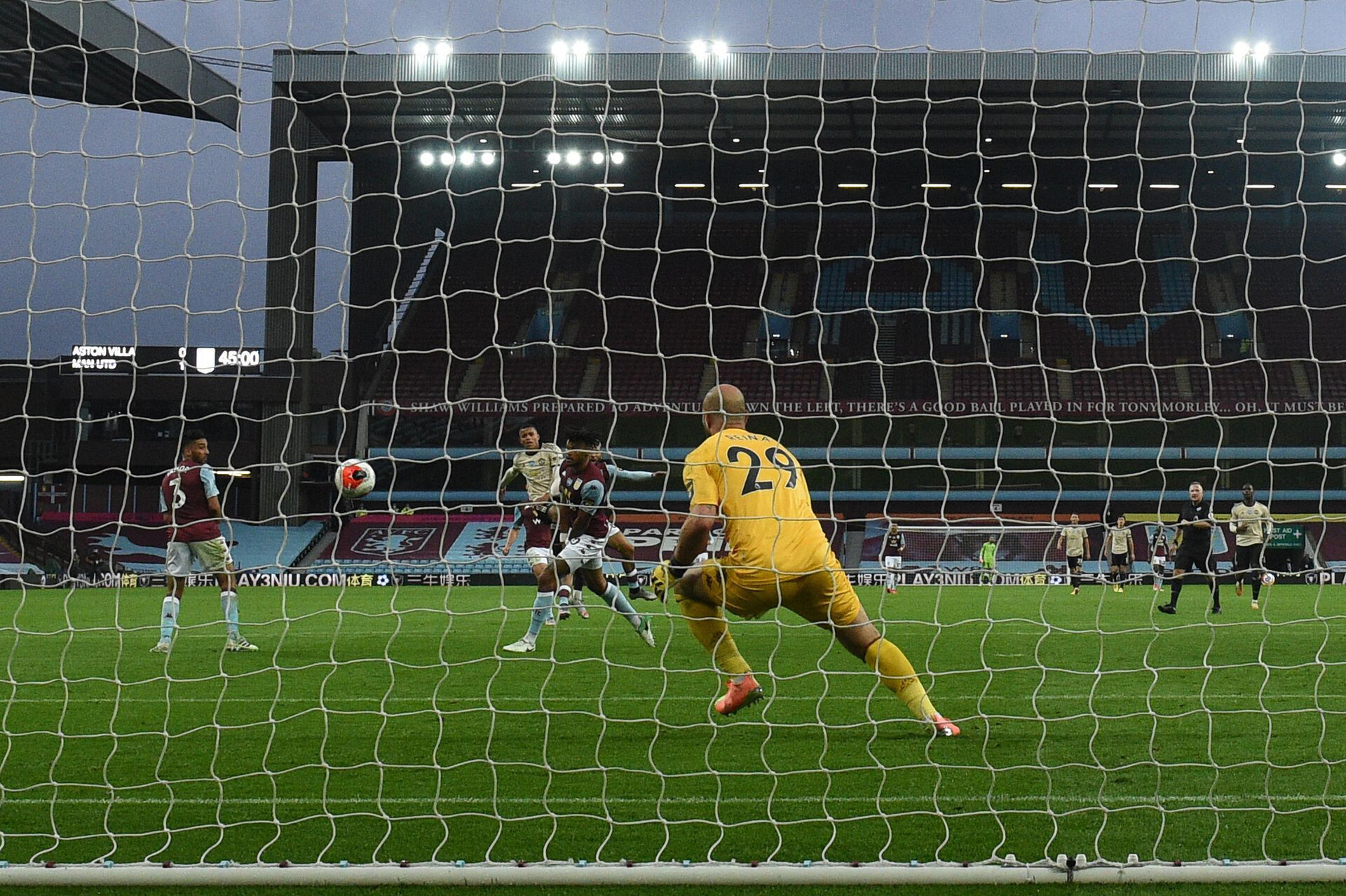 BIRMINGHAM, ENGLAND - JULY 09: Mason Greenwood of Manchester United scores his team's second goal past Pepe Reina of Aston Villa during the Premier League match between Aston Villa and Manchester United at Villa Park on July 09, 2020 in Birmingham, England. Football Stadiums around Europe remain empty due to the Coronavirus Pandemic as Government social distancing laws prohibit fans inside venues resulting in all fixtures being played behind closed doors. (Photo by Oli Scarff/Pool via Getty Images)