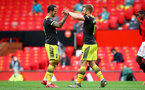 MANCHESTER, ENGLAND - JULY 13: Danny Ings (L) and Stuart Armstrong (R) celebrating Stuart Armstrong goal during the Premier League match between Manchester United and Southampton FC at Old Trafford on July 13, 2020 in Manchester, United Kingdom. Football Stadiums around Europe remain empty due to the Coronavirus Pandemic as Government social distancing laws prohibit fans inside venues resulting in all fixtures being played behind closed doors. (Photo by Matt Watson/Southampton FC via Getty Images)