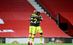 MANCHESTER, ENGLAND - JULY 13: Nathan Redmond (L) and Michael Obafemi (R) celebrating Michael Obafemi goal during the Premier League match between Manchester United and Southampton FC at Old Trafford on July 13, 2020 in Manchester, United Kingdom. Football Stadiums around Europe remain empty due to the Coronavirus Pandemic as Government social distancing laws prohibit fans inside venues resulting in all fixtures being played behind closed doors. (Photo by Matt Watson/Southampton FC via Getty Images)