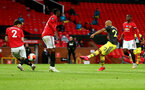 MANCHESTER, ENGLAND - JULY 13: Nathan Redmond of Southampton shoots at goal during the Premier League match between Manchester United and Southampton FC at Old Trafford on July 13, 2020 in Manchester, United Kingdom. Football Stadiums around Europe remain empty due to the Coronavirus Pandemic as Government social distancing laws prohibit fans inside venues resulting in all fixtures being played behind closed doors. (Photo by Matt Watson/Southampton FC via Getty Images)