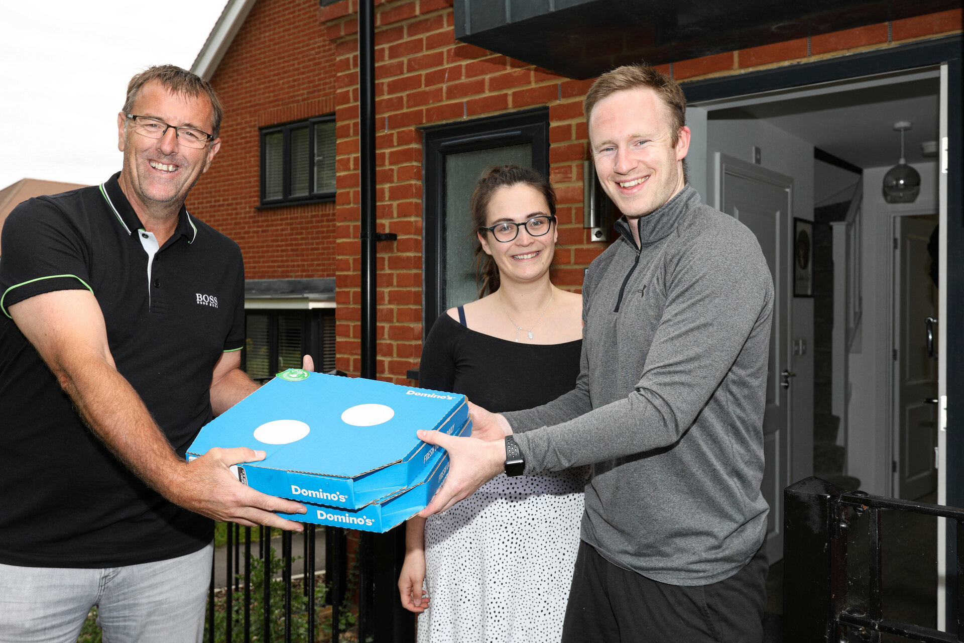 Lee Nicholas and his wife, Kimberley, with Matt. Southampton icon and Saints Foundation ambassador Matt le Tissier presented Domino's pizzas to Saints Foundation volunteers Picture: Chris Moorhouse Tuesday 7th July