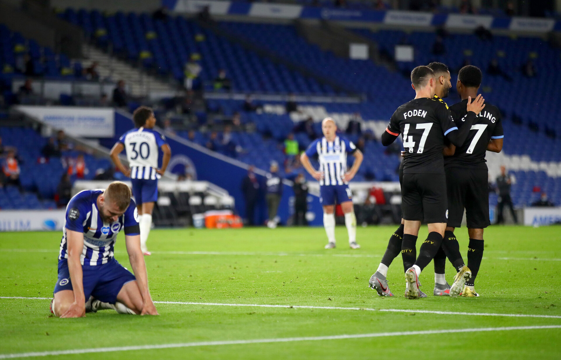 BRIGHTON, ENGLAND - JULY 11: Raheem Sterling of Manchester City celebrates after scoring his team's fifth goal, his hattrick, with team mates Riyad Mahrez and Phil Foden during the Premier League match between Brighton & Hove Albion and Manchester City at American Express Community Stadium on July 11, 2020 in Brighton, England. Football Stadiums around Europe remain empty due to the Coronavirus Pandemic as Government social distancing laws prohibit fans inside venues resulting in all fixtures being played behind closed doors. (Photo by Julian Finney/Getty Images)