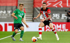 SOUTHAMPTON, ENGLAND - JULY 16: Solly March (L) of brighton and Pierre-Emile Hojbjerg (R) of southampton during the Premier League match between Southampton FC and Brighton & Hove Albion at St Mary's Stadium on July 16, 2020 in Southampton, United Kingdom. Football Stadiums around Europe remain empty due to the Coronavirus Pandemic as Government social distancing laws prohibit fans inside venues resulting in all fixtures being played behind closed doors. (Photo by Matt Watson/Southampton FC via Getty Images)