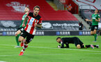 SOUTHAMPTON, ENGLAND - JULY 16: Danny Ings of Southampton celebrates during the Premier League match between Southampton FC and Brighton & Hove Albion at St Mary's Stadium on July 16, 2020 in Southampton, United Kingdom. Football Stadiums around Europe remain empty due to the Coronavirus Pandemic as Government social distancing laws prohibit fans inside venues resulting in all fixtures being played behind closed doors. (Photo by Matt Watson/Southampton FC via Getty Images)